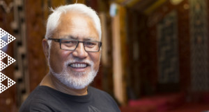Man smiling inside marae